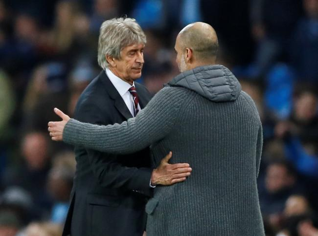 Manuel Pellegrini congratulates Pep Guardiola at full-time. Picture: Action Images