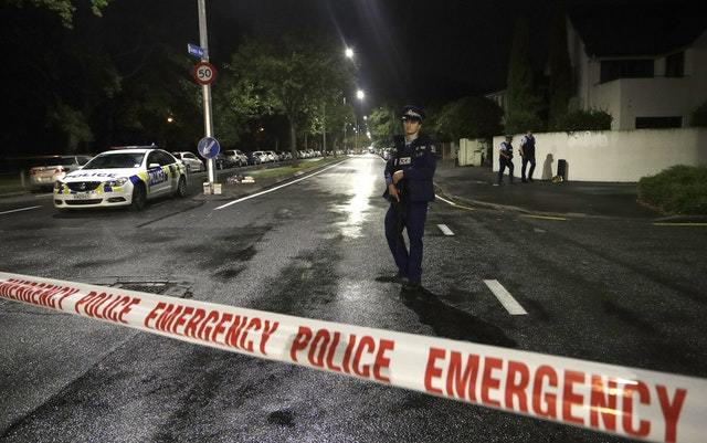 A police officer patrols at a cordon near a mosque in central Christchurch following the attack (AP)