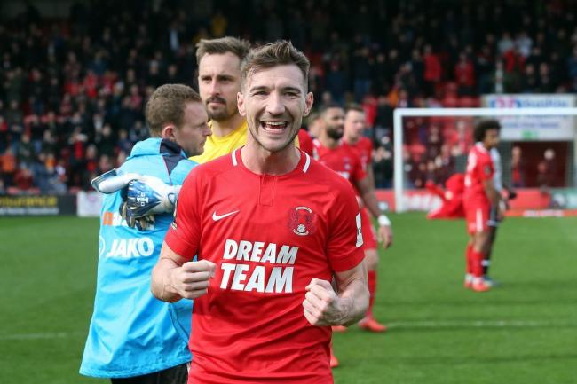 Craig Clay celebrates at full time after the National League win against Wrexham. Picture: Simon O'Connor