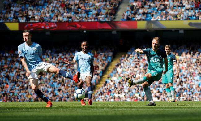 Phil Foden attempts to block a Christian Eriksen shot. Picture: Action Images
