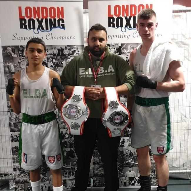 Uzair Maqbool and Jack Daly pose with their belts and head coach Umer.