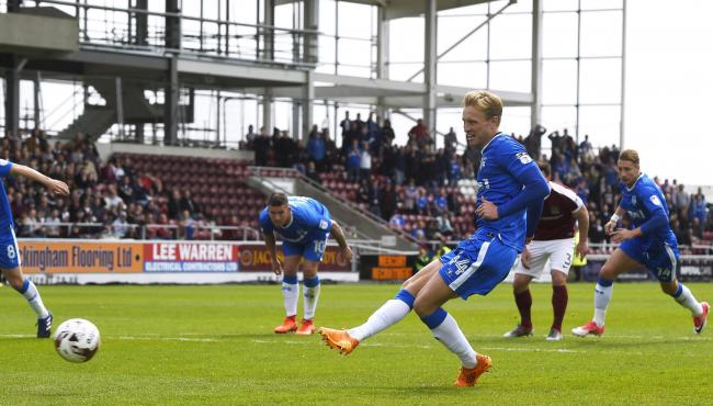 Josh Wright taking a penalty for Gillingham against Northampton Town. Picture: Action Images